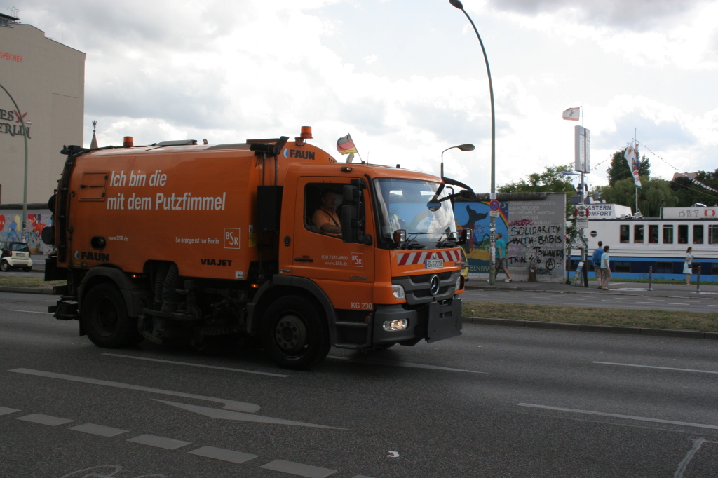 Berlin's street sweepers with humorous sayings.