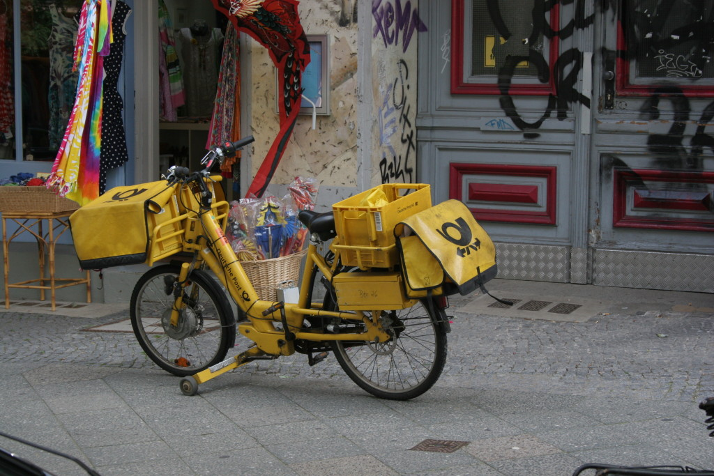 Deutsche Post utility bicycles, electric assist, stabilizing arms, fenders, disc-brakes, heavy duty racks, the whole deal.