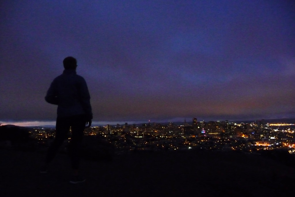 Sunday night hike on Corona Heights on PRIDE weekend, City Hall is a rainbow in the distance.